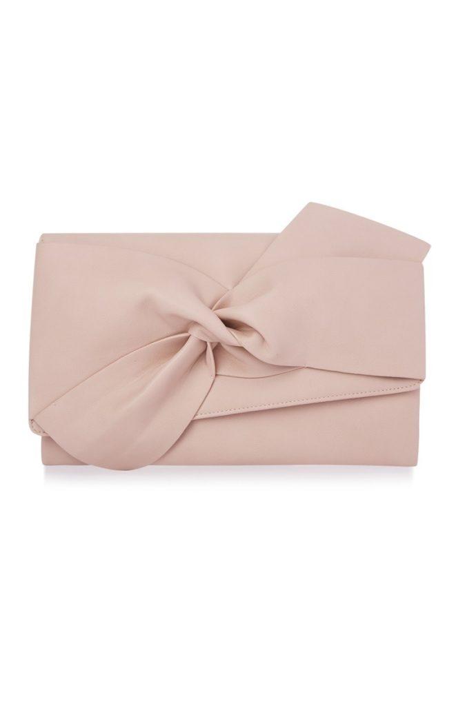 Bolso de mano rosa palo con lazo