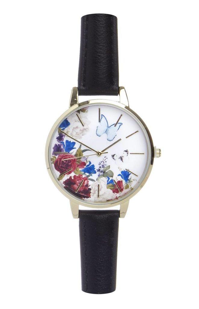 Reloj con flores y correa negra