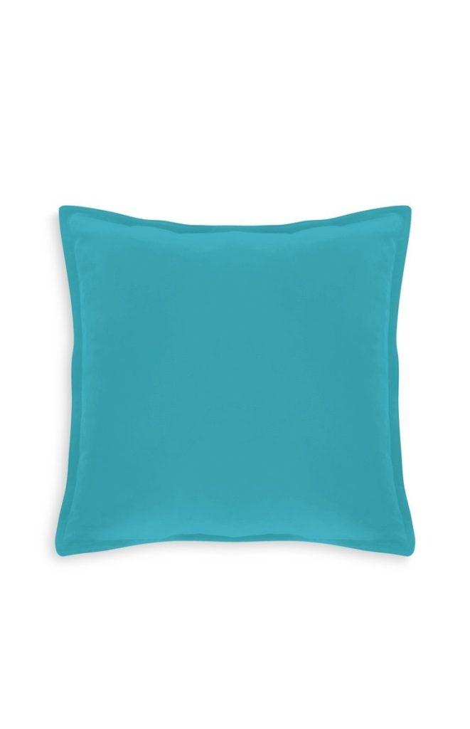 Cojín de terciopelo color turquesa