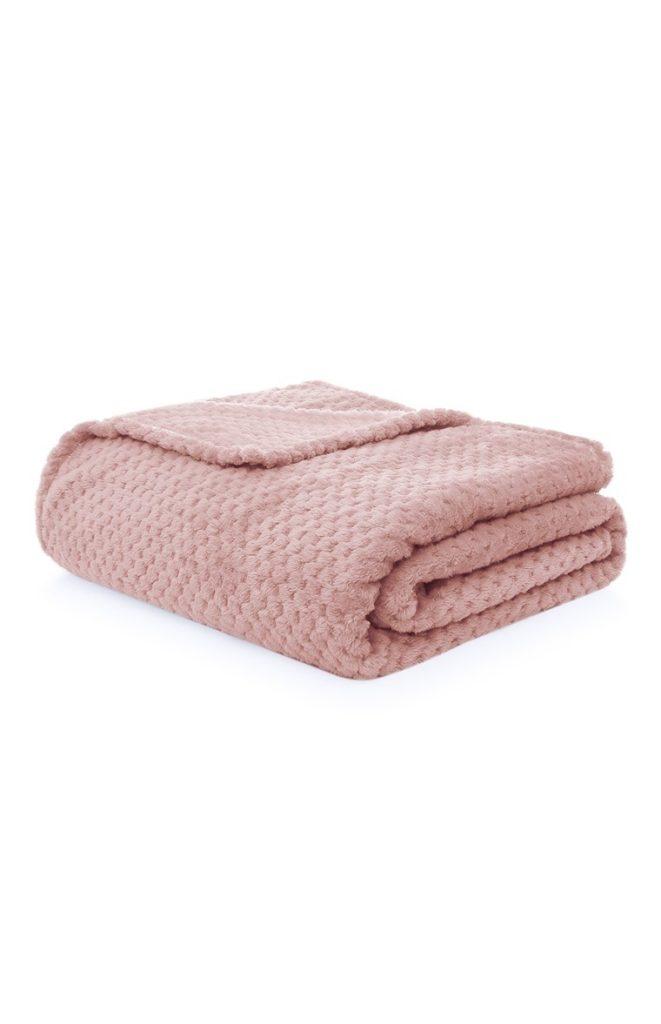 Manta pequeña rosa con texturas